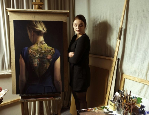 A. Nienartowicz with her work at the studio